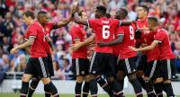 Manchester United players celebrate their first goal scored by Manchester United's Armenian midfielder Henrikh Mkhitaryan during the pre-season friendly game between Manchester United and Sampdoria at the Aviva stadium in Dublin on August 2, 2017.