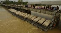 The Royal Thai Navy instals machines at the Songkram River at Nakhon Panom, to speed up floodwater drainage to the Mekong River.