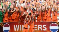 Netherlands' team players celebrate with the trophy after winning the UEFA Women's  Euro 2017.