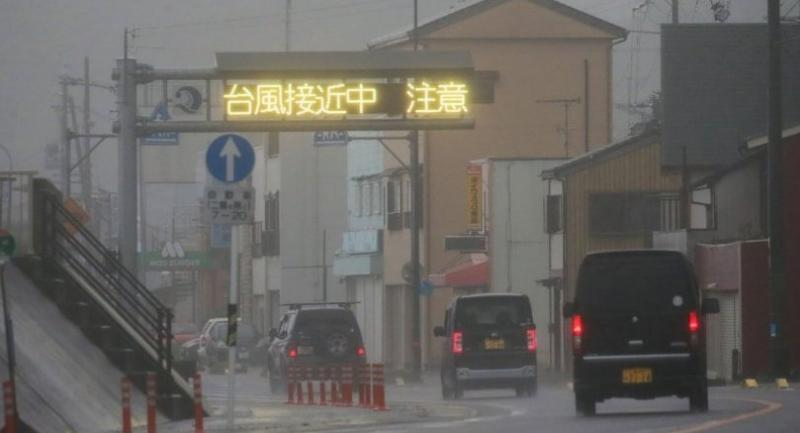 A weather warning is seen on a traffic board, reading in Japanese