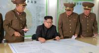 A picture shows North Korean leader Kim Jong-Un (C) inspecting the Command of the Strategic Force of the Korean People's Army (KPA) at an undisclosed location.