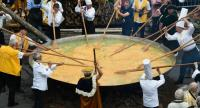 Members of the World Brotherhood of the Huge Omelet create a 6500 egg omelet within a 4 metre diameter frying pan on August 15, 2015 in Malmedy.  // AFP PHOTO