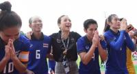 National women's team manager Nualphan Lamsam and her players thank the fans after the win versus Myanmar,