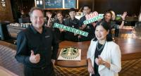 Murrey Darling, managing director of Starbucks Coffee (Thailand) Ltd (left) and Sumonpin Jotikabukkana, marketing and communications director (right), together with Starbucks partners, celebrate their newest store at Zpell Rangsit.