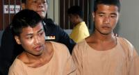 (FILE) - Myanmar migrant workers, who are accused of the killing of two British tourists, Zaw Lin (R) and Wai Phyo (L) are escorted by a Thai police officer after they were sentenced to death at the Samui Provincial Court. // EPA PHOTO