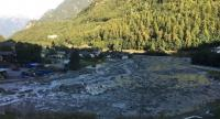 A handout photo released on August 24 by the Police Cantonale des Grisons shows a partial view of the landslide in the Swiss village of Bondo on August 23.//AFP