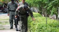 An Explosive Ordnance Disposal team inspects the area around the Supreme Court on Chaengwattana Road.