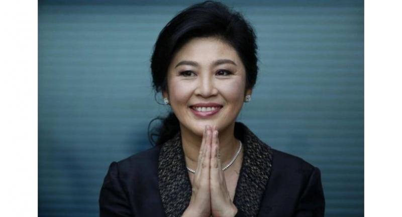 Former Thai prime minister Yingluck Shinawatra greets supporters as she arrives to deliver closing statements in her trial at the Supreme Court's Criminal Division for Persons Holding Political Positions in Bangkok, Thailand on Aug 1, 2017.PHOTO: EPA