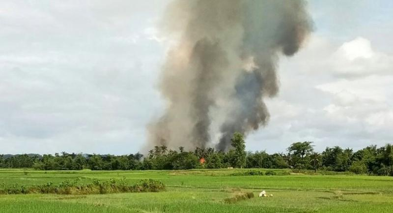 Smoke rises from what is believed to be a burning village in the area near Maungdaw in Myanmar's Rakhine state on August 30.//AFP