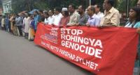Protesting the atrocities against Rohingyas in Myanmar, Sommilito Natto Parishad forms a human chain in Sylhet city yesterday. Photo: Star