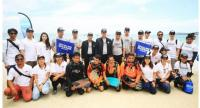 """Officials from the TAT, Rayong Province, the Ministry of Natural Resources and Environment, PTT Global Chemical and the ECOALF Foundation at the launch of the """"Upcycling the Oceans, Thailand"""" project on Koh Samet. Photo: Tourism Authority of Thailand"""