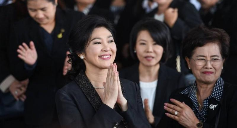 Former prime minister Yingluck Shinawatra greets her supporters at the Supreme Court on August 1, 2017, before making a closing statement to the court in the negligence case over her government's rice-pledging scheme.
