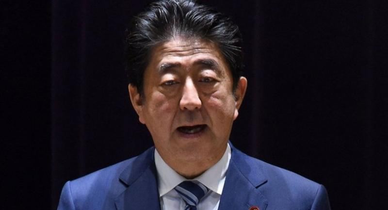 Japan's Prime Minister Shinzo Abe delivers a speech at a gathering of Self-Defence Force senior officers at the Defence Ministry in Tokyo on September 11, 2017. / AFP PHOTO