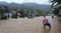 The road to Phuket International Airport is flooded Friday morning. Heavy rains caused flight delay at the airport.