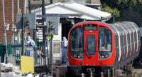 Police forensics officers works alongside an underground tube train at a platform at Parsons Green underground tube station in west London on September 15, 2017, following an incident on an underground tube carriage at the station. // AFP PHOTO