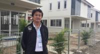 NHA's governor Tachaphol Kanjanakul shows a residential housing project in Chiang Mai yesterday.