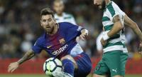 Barcelona's forward from Argentina Lionel Messi (L) vies with Eibar's defender from Spain David Junca during the Spanish league football match FC Barcelona against SD Eibar at the Camp Nou stadium.