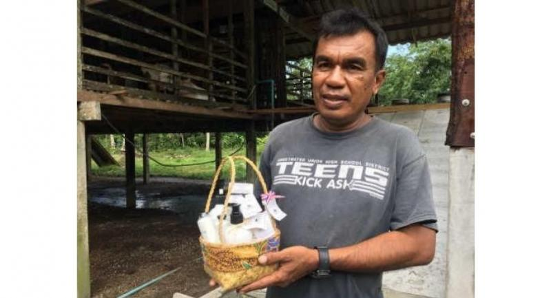 Chiya Anafarang, owner of Nanua Goat Farm, shows off a gift set of personal care products derived from goat's milk under his Nanua Goat Farm brand.