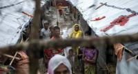 Rohingya Muslim refugees stand in an alley of Kutupalong refugee camp in the Bangladeshi district of Ukhia on September 28, 2017. /AFP