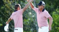Kevin Chappell and Charlie Hoffman of the U.S. Team celebrate on the 13th green after defeating Anirban Lahiri of India and the International Team and Charl Schwartzel of South Africa and the International Team 6