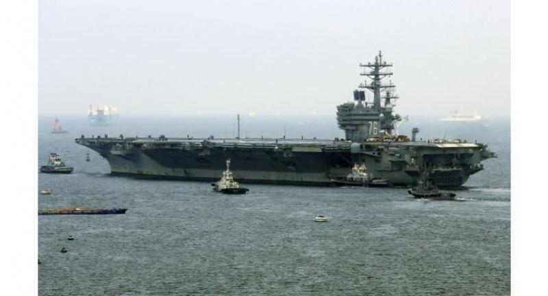 US nuclear-powered aircraft carrier USS Ronald Reagan departs the Yokosuka naval base in Yokosuka, Kanagawa prefecture on September 8, 2017. (AFP-Yonhap)