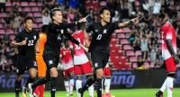 Teerasil Dangda, middle, reacts after scoring the goal for Thailand .