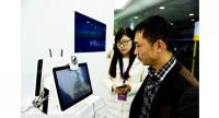 A visitor tries out the facial recognition technology at an internet finance expo in Hangzhou, Zhejiang province, Nov 20, 2015. [Photo/IC]