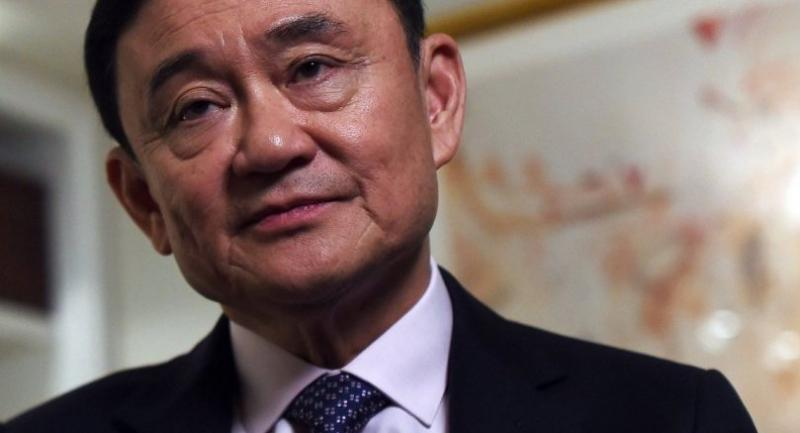 This file photo from March 9, 2016 shows deposed former Thai prime minister Thaksin Shinawatra answering a question during an interview in New York. / AFP