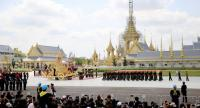 Loyal subjects watch as the 13-tonne Great Victory Chariot is pulled during a procession rehearsal yesterday at Sanam Luang. Four processions were held in preparation for the Royal Cremation of His Majesty the late King Bhumibol Adulyadej next week.