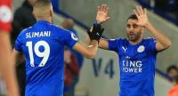 Leicester City's Algerian midfielder Riyad Mahrez (R) celebrates scoring his team's first goal during the English Premier League football match between Leicester City and West Bromwich Albion.