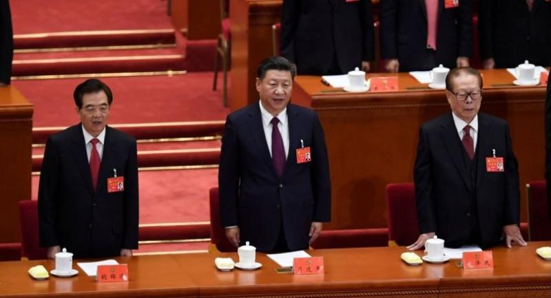China's President Xi Jinping (C) sings the National Anthem with former presidents Jiang Zemin (R) and Hu Jintao (L) during the opening of the 19th Communist Party Congress at the Great Hall of the People in Beijing on October 18,.//AFP