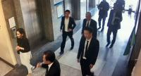 CCTV footage from the Department of Special Investigation (DSI) shows Panthongtae Shinawatra reporting on Tuesday after being charged for alleged money laundering and summoned by the department. He is accompanied by three men and his younger sister.