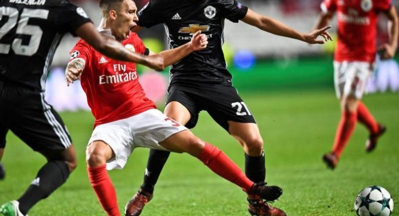 Benfica's Spanish defender Grimaldo Garcia (C) vies with Manchester United's Ecuadorian defender Antonio Valencia (L) and Manchester United's Spanish midfielder Ander Herrera (R).
