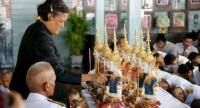 Her Royal Highness Princess Maha Chakri Sirindhorn performs an auspicious offering ceremony for decorative fresh flowers, banana stalks, fruit, and vegetables.
