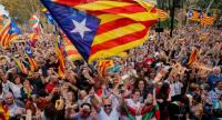 People celebrate after Catalonia's parliament voted to declare independence from Spain in Barcelona on October 27, 2017.