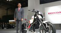Honda Motor President and CEO Takahiro Hachigo with Honda Riding Assist-e, the company's latest unique balance   control technology debuted during 45th Tokyo Motor Show 2017 last Wednesday.