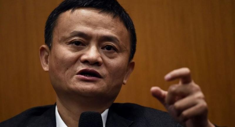 (FILES) This file picture taken on March 23, 2017 shows China's Alibaba Group founder and executive chairman Jack Ma gestures while talking to mediapersons in Kuala Lumpur. / AFP PHOTO