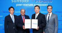 Shekhar Mundlay, second from left, CEO for the beverage division at Suntory Beverage