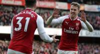 Arsenal's Welsh midfielder Aaron Ramsey (R) celebrates with Arsenal's German-born Bosnian defender Sead Kolasinac.