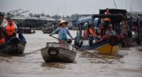 Lives and trade at floating Cai Rang Market in Can Tho, a city in the Mekong Delta, Southern Vietnam where is now being affected by climate change and upstream development projects