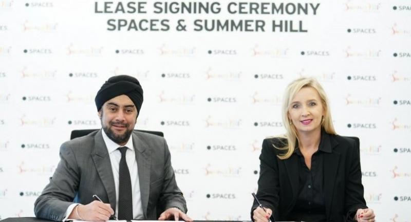 Noelle Coak, right, Spaces country head (Thailand, Taiwan, Korea), and Prab Thakral, president and group CEO of Boutique Corp, on Tuesday sign the lease agreement for the first Thai location of Spaces, at Summer Hill.