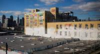 A picture shows the historic graffiti mecca 5 Pointz after being painted over by developers in the Long Island City neighbourhood of the Queens borough of New York City. / AFP