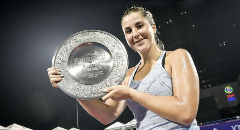 Belinda Bencic poses with her shield after winning her third WTA title in Hua Hin.