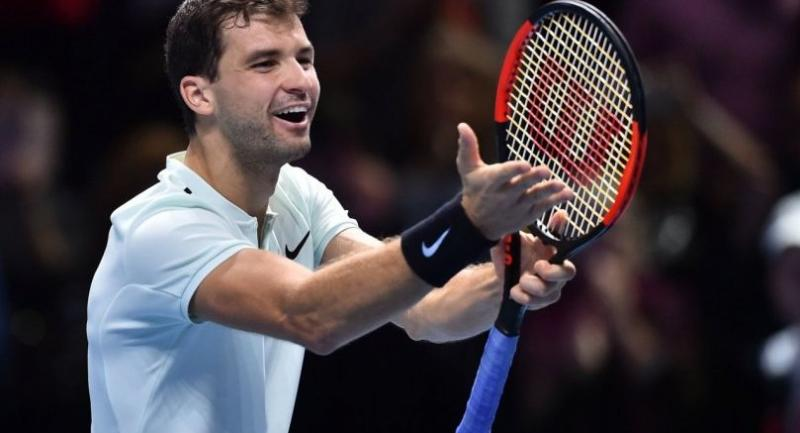 Bulgaria's Grigor Dimitrov celebrates his three set victory over Austria's Dominic Thiem during day two of the ATP World Tour Finals tennis tournament at the O2 Arena in London on November 13, 2017. / AFP PHOTO