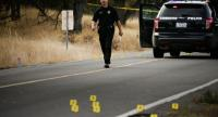 A law enforcement officer is seen at one of many crime scenes after a shooting on November 14, 2017, in Rancho Tehama, California./AFP