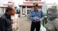 BAB artistic director Apinan Poshyananda, right, visits Wat Arun with Huang Yong Ping, left, who will mount an installation at Wat Pho. Photo courtesy of BAB 2018