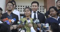 Jomsap Saenmuangkhot, a former teacher, talks to reporters yesterday after hearing the Supreme Court's decision not to order a retrial into the fatal hit-and-run accident in which she was originally convicted and jailed, but later acquitted.