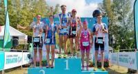 Michael Raelert of Germany and Amelia Watkinson of New Zealand stand on top of the podium after winning the Laguna Phuket Triathlon
