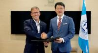 John N. Stewart, Senior Vice President and Chief Security Officer, Cisco, and Noboru Nakatani, Executive Director, INTERPOL Global Complex for Innovation (IGCI), sign collaboration agreement to combat cybercrime.