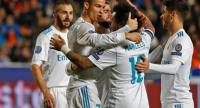 Real Madrid's Portuguese forward Cristiano Ronaldo (2nd-R) celebrates with teammates his first goal, and his team's fifth, during the UEFA Champions League Group H match between Apoel FC and Real Madrid on November 21, 2017.
